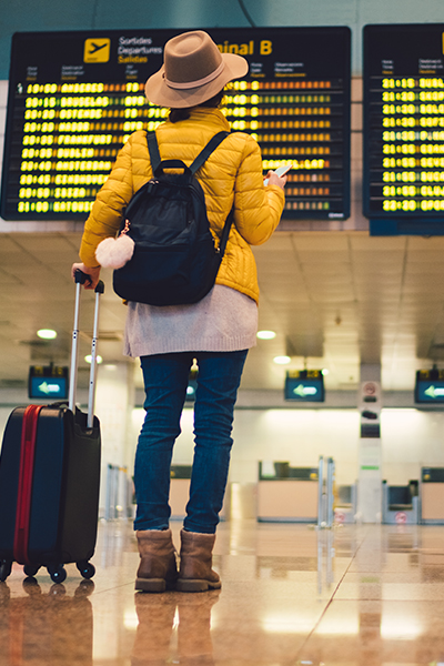 Woman in airport looking at phone